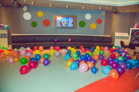 Different color balloons on the floor . Flat lay of colorful balloons . holiday, childrens party, a games room, a box filled with small colored balls