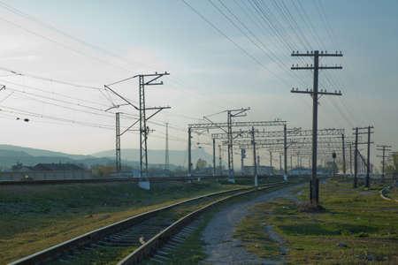 local railway and train station . Railroad tracks . Straight railway line . Empty summer railway . 스톡 콘텐츠