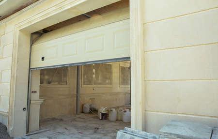 Automatic Electric Roll-up Gate Or Push-up Door In The Modern Building Ground Floor . Shutter door or roller door and concrete floor outside .White Automatic shutters in a house . gates in the garage