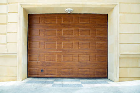 Automatic Electric Roll-up Gate Or Push-up Door In The Modern Building Ground Floor . Shutter door or roller door and concrete floor outside . Brown Automatic shutters in a house . gates in the garage Stock Photo