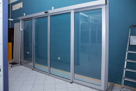 Double sliding glass doors with automatic motion sensor. Entrance to the office, train station, supermarket For sale .