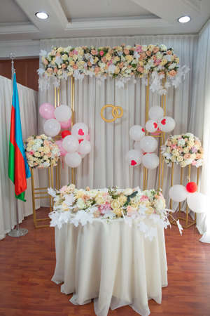 Modern Azerbaijan marriage celebration table concept and home decoration . registry office, newlyweds at the wedding table, couple in love, signed a marriage contract . Foto de archivo