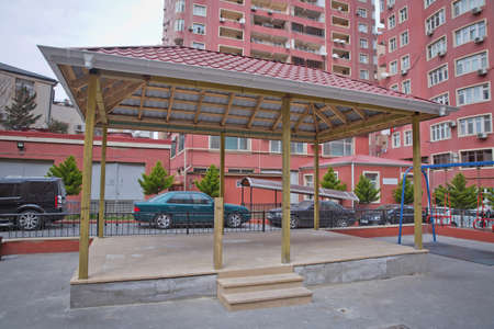 Gazebo in the yard of the house . Yard with gazebo and Playground modern housing complex