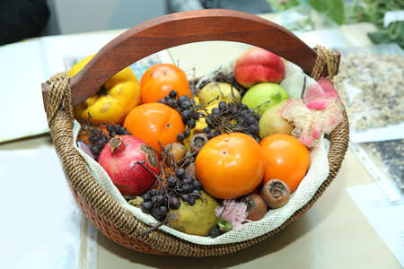 In the basket are pomegranates, dates, pears, quinces, mashed potatoes black hawthorn  版權商用圖片