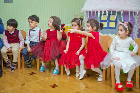 Baku, Azerbaijan . 26.01.2020 . New Year celebration in kindergarten with Ded Moroz Grandfather Frost and Snow-maiden. Little children playing . Santa Claus on New Year's holiday with children.