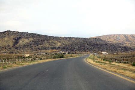 Road in the desert - Gobustan Azerbaijan . Gobustan near Baku, Azerbaijan. Asphalt road to Gobustan