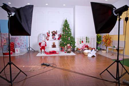Baku, Azerbaijan. 14. 07. 2019 Interior of a modern photo studio . studio photo with softbox . Decorated Christmas room with beautiful tree . New Year's decor and tree in children's playroom. Editoriali
