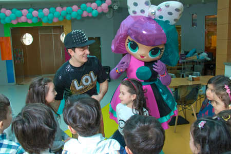 Baku, Azerbaijan. 02.04.2019 . Children's birthday party with Lol animators. Happy group of children at a birthday celebration dressed in the style of Lol with an animator . Éditoriale