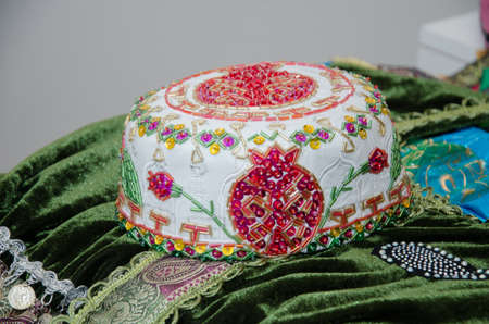 They would wear a rider under the headgear white hat, stroke . Araxchin is a national hood of Azerbaijan.Tradional Azerbaijani souveniers hats and knitted clothing sold