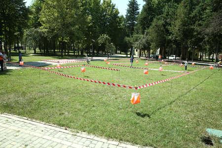 Azerbaijan, Ismayilli 26.08.2016: Outdoor orienteering check point activity . line at an orienteering . Check point Prism and composter for orienteering. Navigation equipment. Redactioneel