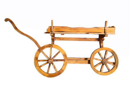 Conservative ancient wagon on white background . Wooden rustic four-wheel cart . onion in wooden cart bags . Wagon wood. Ancient cargo carriage against a red wooden background