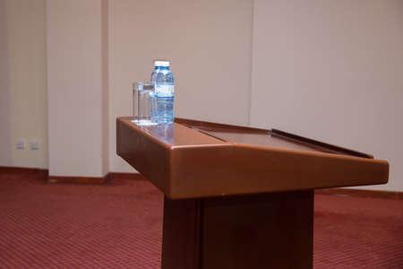 Wooden speech stand in conference room . Seminar Podium . Wooden podium tribune stand rostrum . Stock fotó