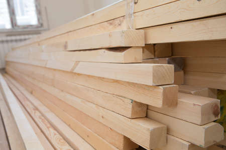 Hardware store, construction material for background and texture, Wood products, planks, lining, boards for construction works . Timber industry objects. Finished wood beams or plank at a warehouse.