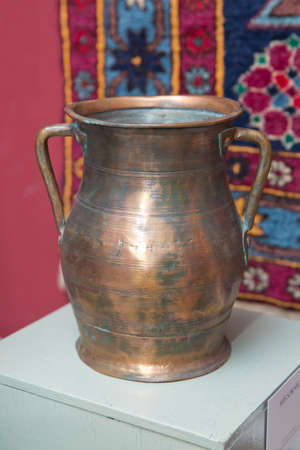 Azerbaijan Baku 04.12.2020 . Various amphorae exhibited in the national arcaeological museum . Copper pottery exhibition . Sernic . Redakční