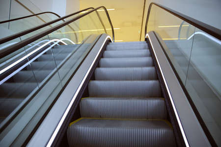 Modern escalator electronic system moving. Moving escalator in the business center of a city
