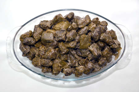 Azerbaijan meal, stuffed grape leaves, rice and spices . dolma, stuffed grape leaves in a bowl, turkish and greek cuisine Imagens