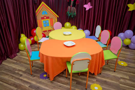 School kindergarden nursery dining room . children's furniture and toys in kindergarten . empty tables . refectory of a school for children with chairs and tables without people .y-free stock