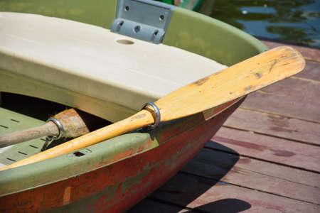 oar: Part of a wood oar and boat