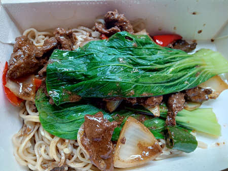 noodles with beef and mustard leaves photo