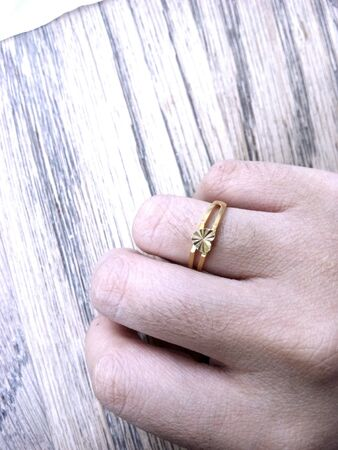 gold: Hand with gold ring Stock Photo