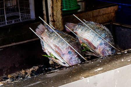nile tilapia: Fresh delicious grilled nile tilapia. Stock Photo