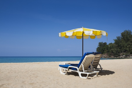Sun umbrella and chairs on the Nai thon beach of Phuket island photo