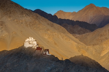 Ruined fort sitting above the Tsemo Gompa on a barren mountain above Leh photo
