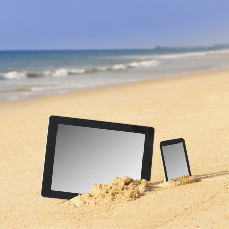 Tablet computer and smartphone on the beach   photo