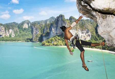 Adult climbing hard overhanging wall in Krabi, Thailand