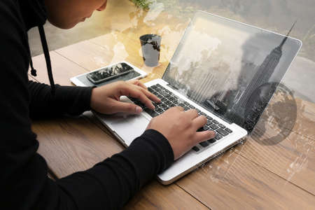 coffee filter: Cropped shot Silhouette of a mans hands using a laptop at home, rear view of business man hands busy using laptop at office desk, young male student typing on computer sitting at wooden table, phone on table, coffee, filter sun