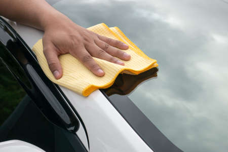 microfiber cloth: A man hand cleaning car with microfiber cloth