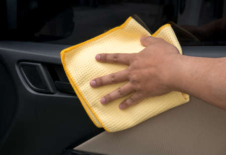 Hand Cleaning Interior Car Door Panel With Microfiber Cloth Stock