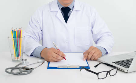 pathologist: Professional doctor writing medical records on a clipboard with computer and medical equipment all around, desktop