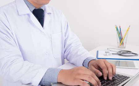 x ray equipment: Doctor at desk working at laptop on table, healthcare and prevention concept