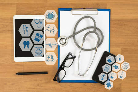 medical concept: Medical equipment: gray stethoscope and tablet ,desktop top view, interface as medical concept