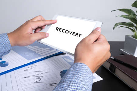 man using tablet computer show word Recovery