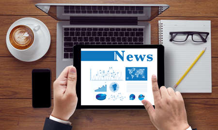 news update: News Update Concept, on the tablet pc screen held by businessman hands - online, top view
