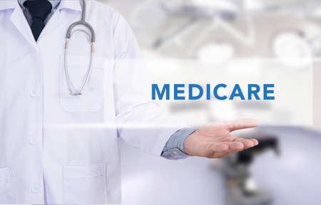 medicare: Health concept - MEDICARE on Medical Doctor holding hands Stock Photo