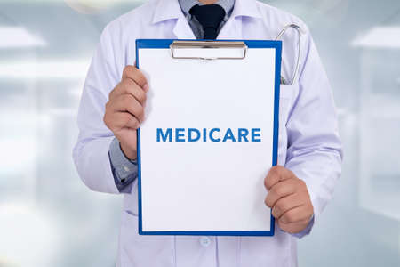 medicare: Health concept - MEDICARE, on Professional doctor writing medical records on a clipboard