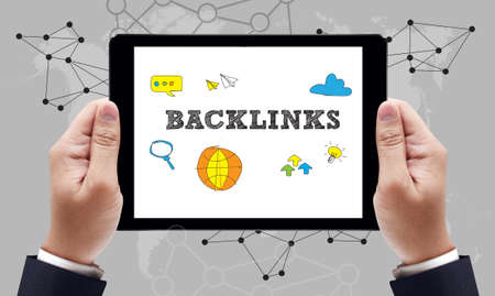 backlinks: Backlinks Technology  Web Concept on the tablet pc screen held by businessman hands, top view Stock Photo