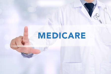 Health concept - MEDICARE, Medicine doctor working with computer interface as medical concept