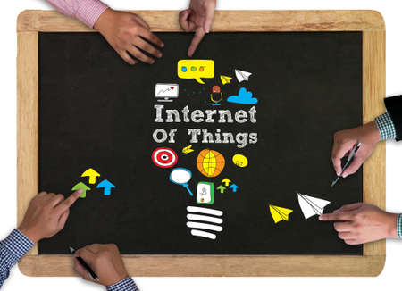 digitization: vintage blackboard with wooden frame chalkboard Internet of things (IOT) concept