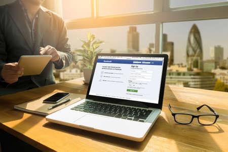 Bangkok, Thailand - Mar 10, 2015: Man on a Computer Browsing Facebook Website