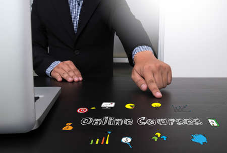 Business team hands at work with financial reports and a laptop, top view Online Courses concept