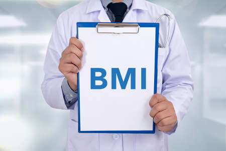 excess: BMI body mass index on Professional doctor writing medical records on a clipboard