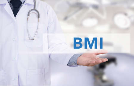 BMI: Doctor hand touching BMI sign on virtual screen