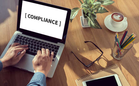 compliant: Compliance Concept ,Budget Concept man hand on table Business, coffee, Split tone