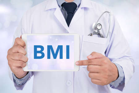 BMI: Doctor holding a tablet pc BMI