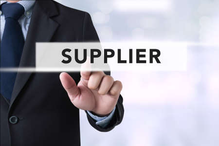 suppliers: Businessman touch suppliers concept on  Page concept on blurred abstract background Stock Photo