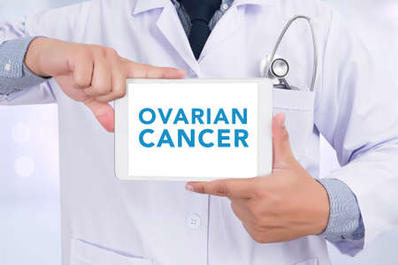 ovarian: OVARIAN CANCER CONCEPT Doctor holding  digital tablet